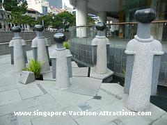 Sculpture The Merchants of Singapore outside Central Shopping Mall
